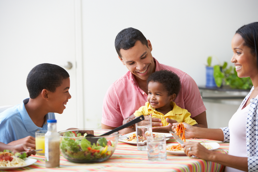 bigstock-Family-Eating-Meal-Together-At-46447096