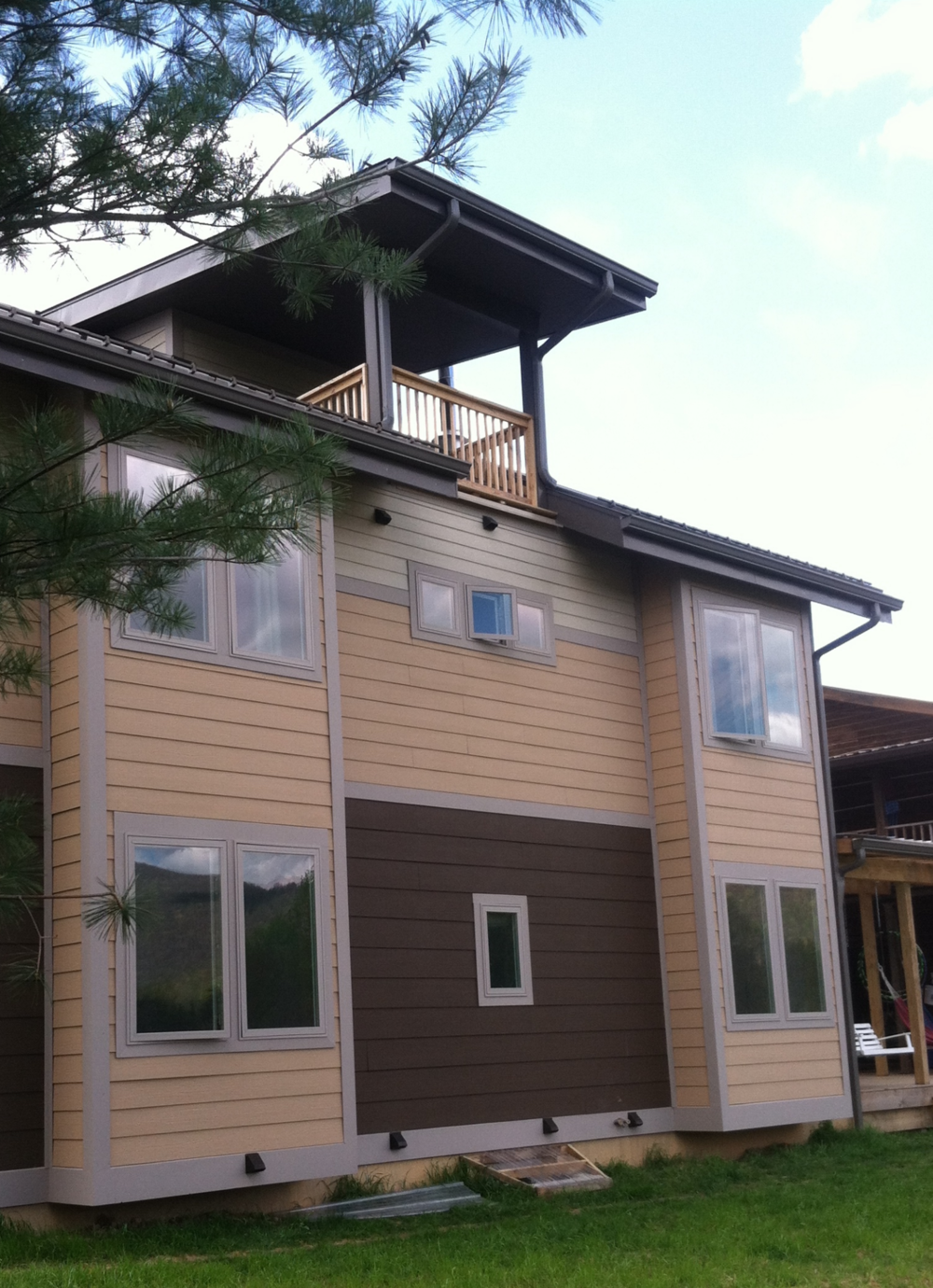Concrete siding on SIPs along with High Performance windows
