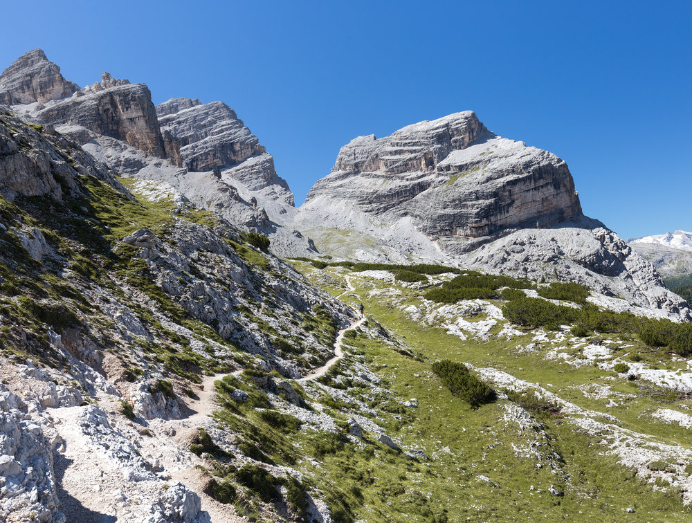 Alex hiking towards that V in the mountains: Forcella del Lago
