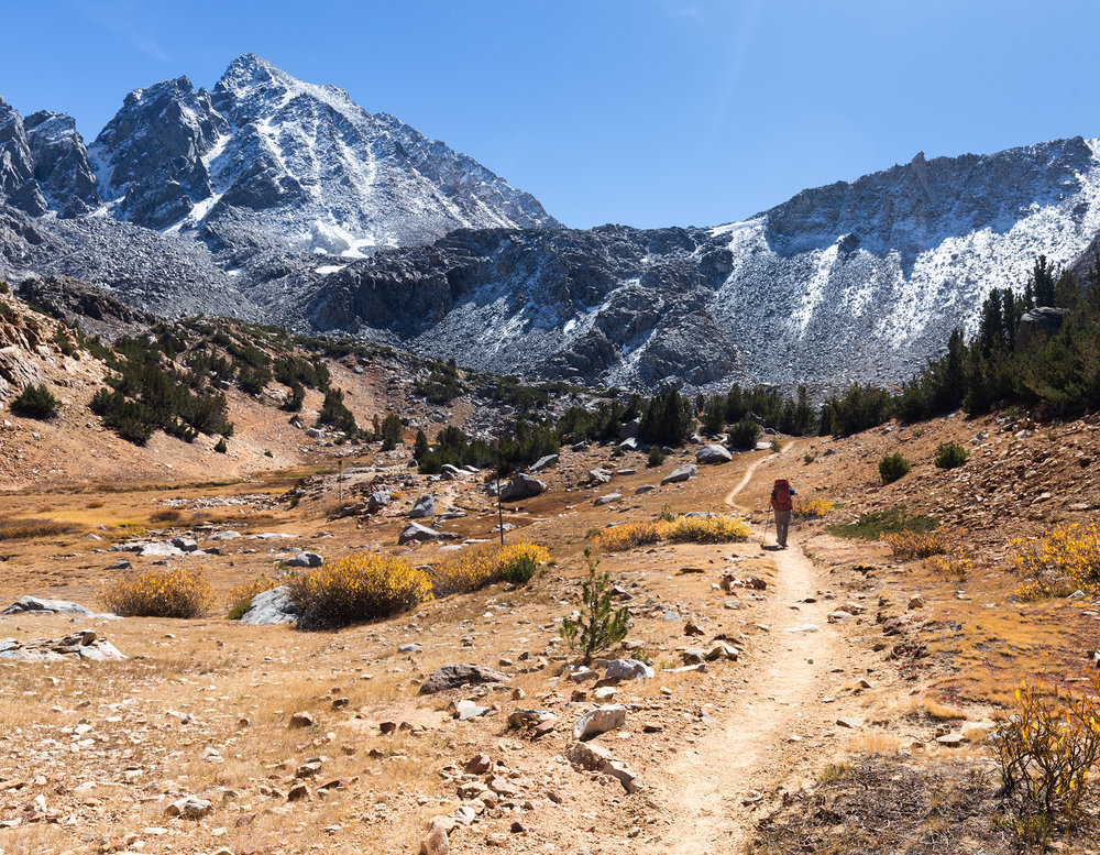 Heading toward Bishop Pass, which is the lowest point of the V, formed by the two ridges, in the upper center of the photo