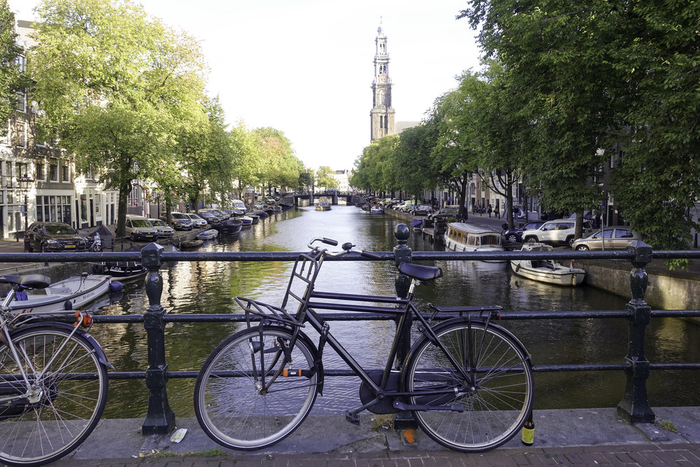 Canals and bikes...where else but Amsterdam? All that's missing is a tourist smoking a joint.