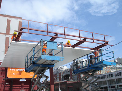Workers installing canopy deck