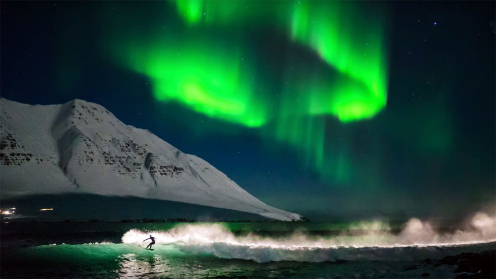 SurfingUnderNorthernLights-1024x576.jpg