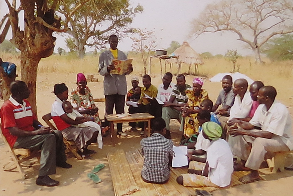 Parent meeting under the trees - no permanent building to meet in