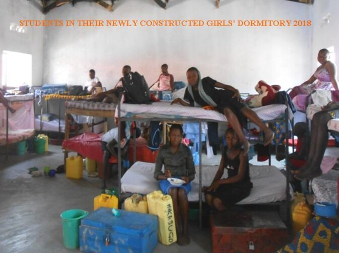 STUDENTS IN THEIR  NEWLY COMPLETED  DORMITORY..jpg