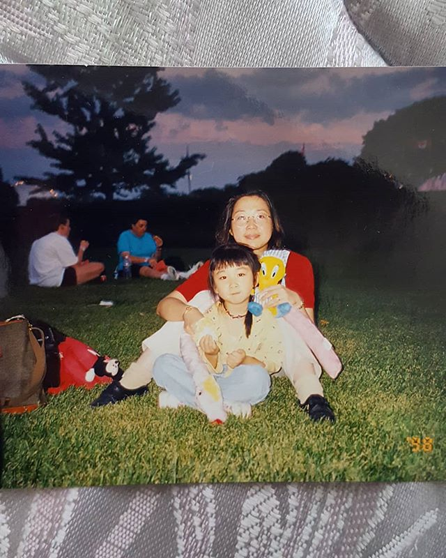 been recovering from the flu at my parents' this weekend and found this photo in their new home. ' late summer '98, mama and auntie hopped on multiple packed buses, subway and streetcars to take me to CNE from northern scarborough. this is a picture of my mama, the stuffies we won and me eating a sausage bao on a grassy lawn at sunset. it was taken by my auntie.