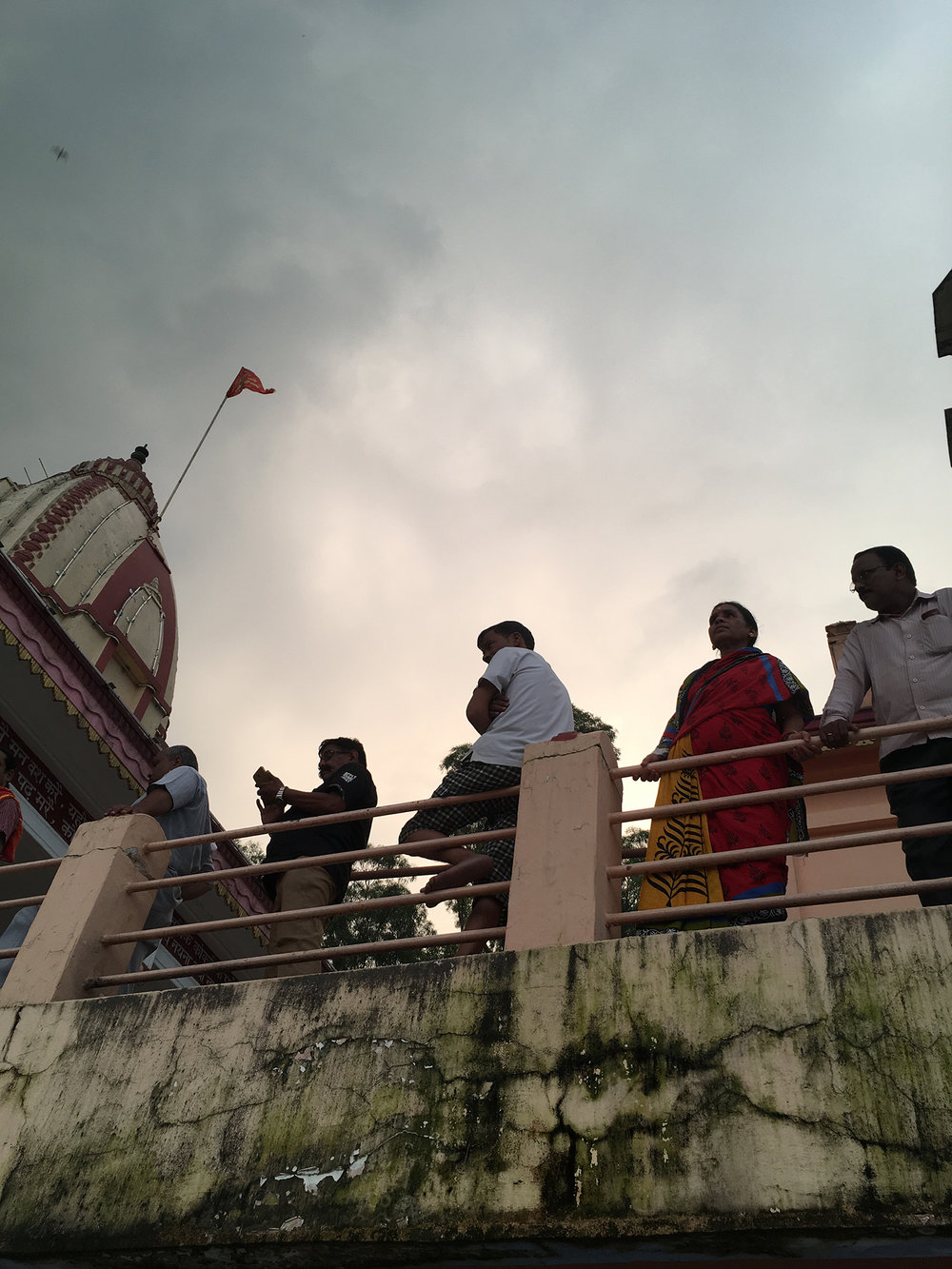 Spectators on the bank of the Ganga
