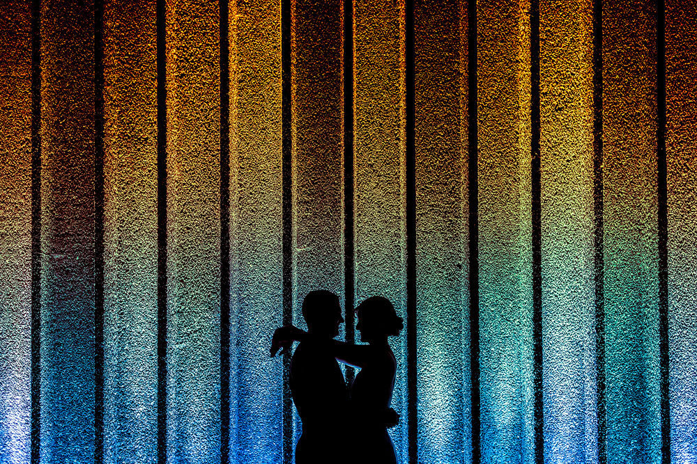 Bride and groom silhouette outside the National Arts Centre in Ottawa Ontario