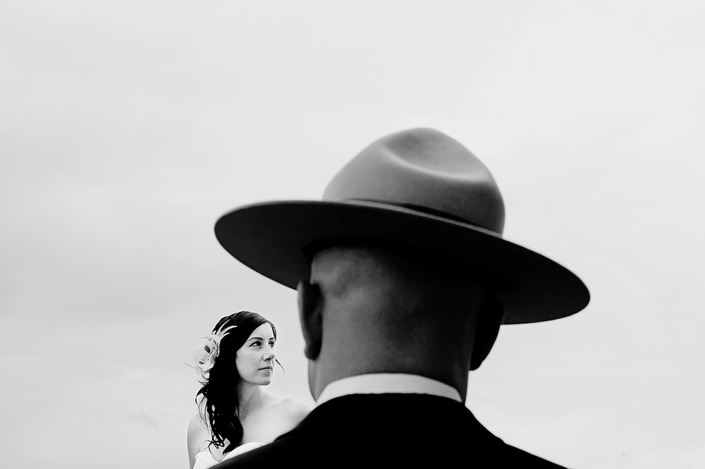 Bride and groom portrait with the groom wearing a campaign hat