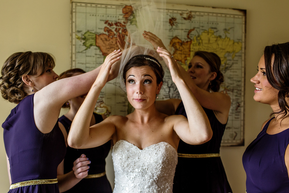 bride and bridesmaids adjusting veil before wedding ceremony ottawa