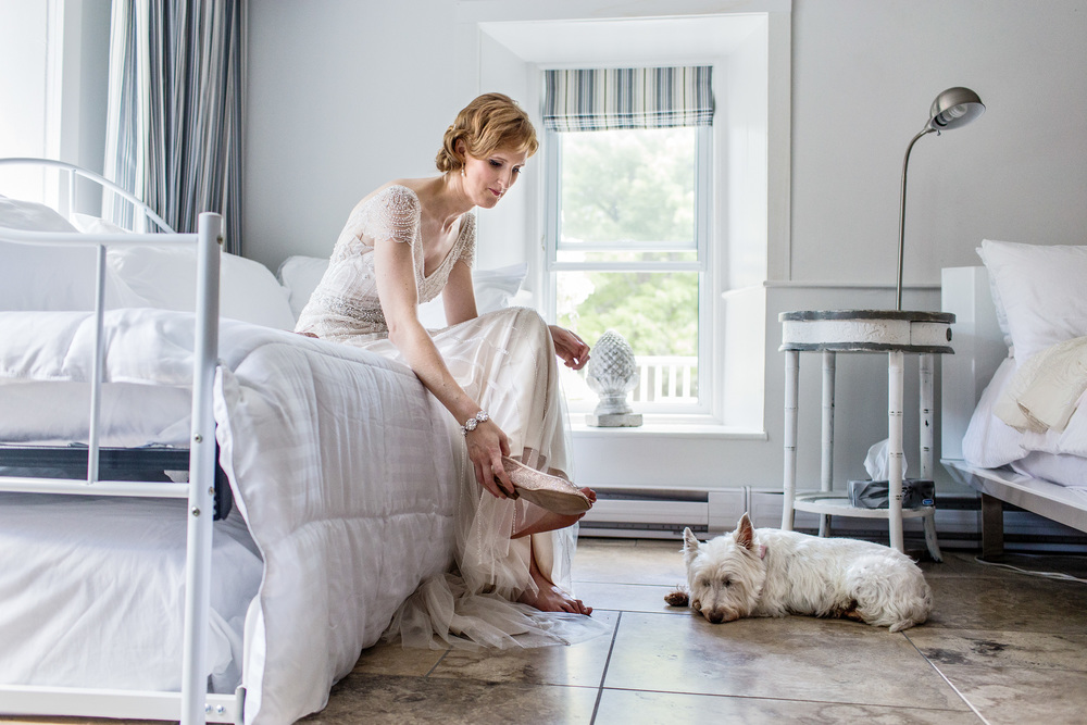 bride gets ready for wedding as her dog awaits