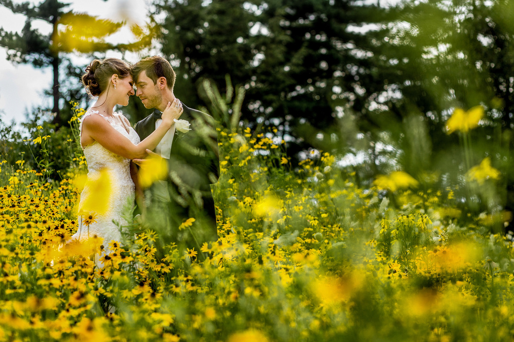 bride groom portrait in flower field le belvedere wedding