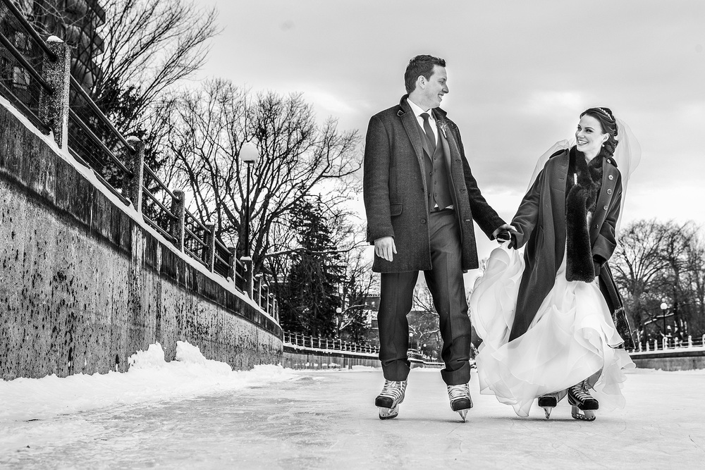 bride and groom take a skate on rideau canal during a winter wedding