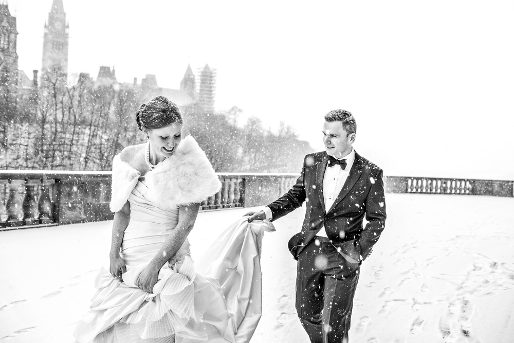 bride groom walking on terrace of chateau laurier wedding in winter