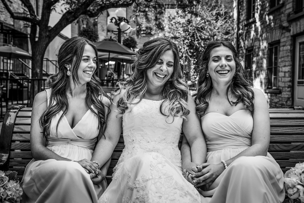 bride has a nice moment with bridesmaids during wedding reception in byward market ottawa