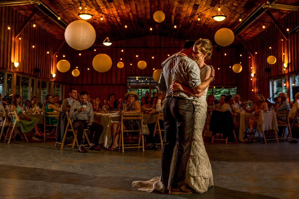 bride and groom take first dance at a saunders farm wedding