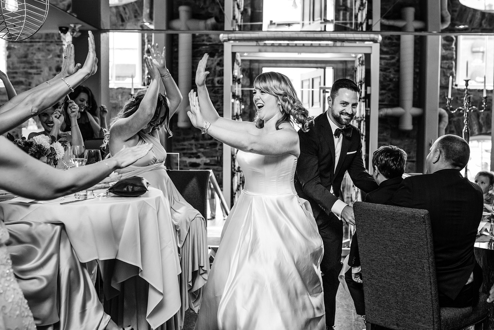 bride gives high five during grand entrance at an eighteen restaurant wedding in ottawa