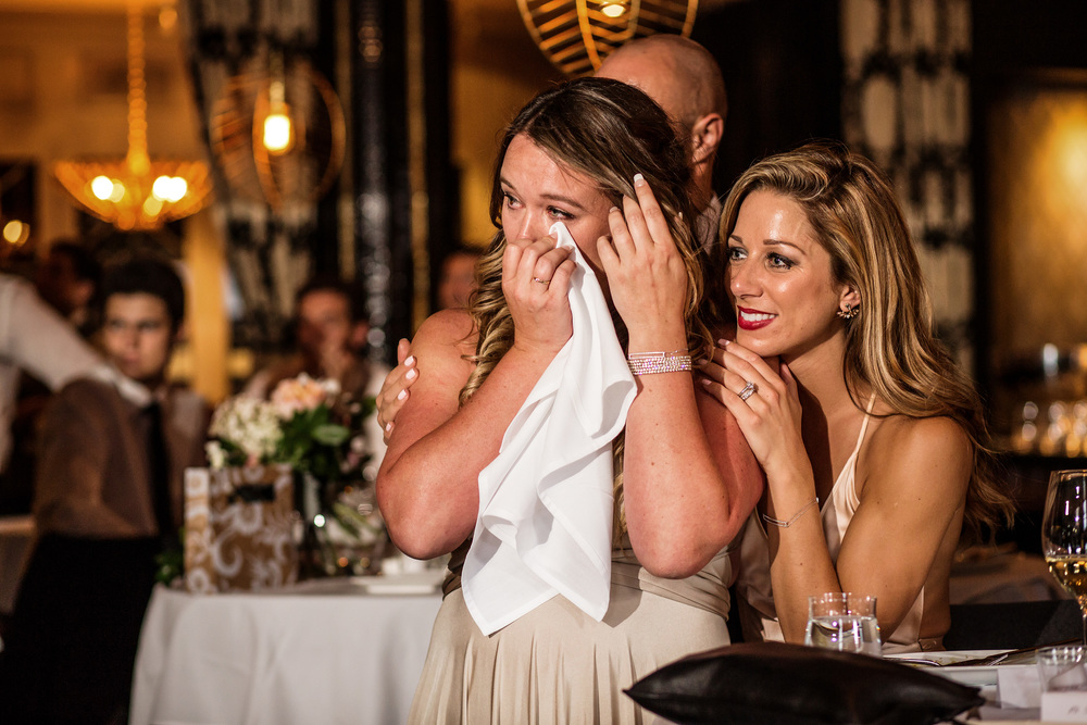 bridesmaids react to groom speech during an eighteen restaurant wedding reception in ottawa