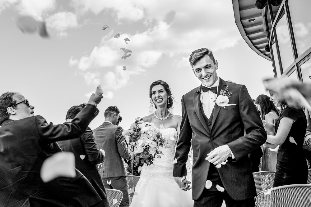 bride and groom walk down aisle during a lago wedding ceremony in ottawa
