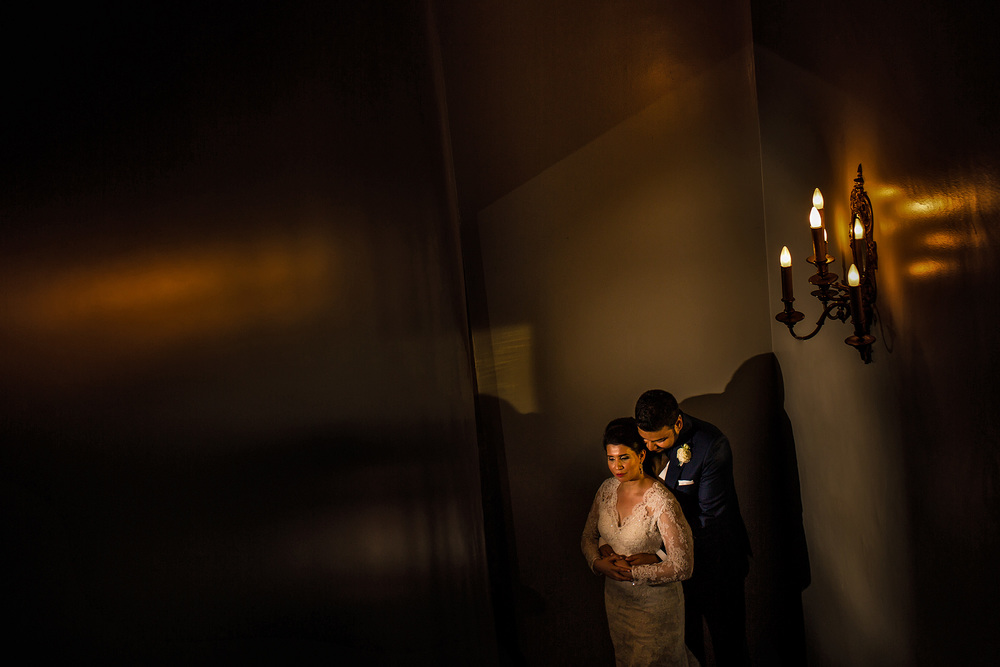 bride and groom pose for portrait in the chateau laurier