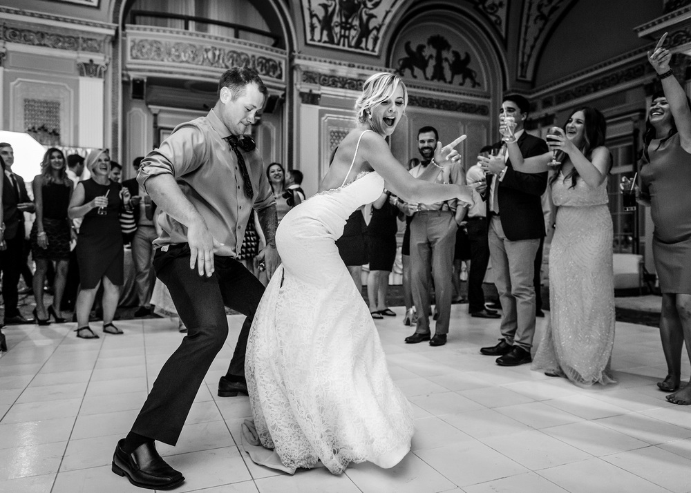 bride and guest have some fun on dance floor during a fairmont chateau laurier ballroom wedding reception