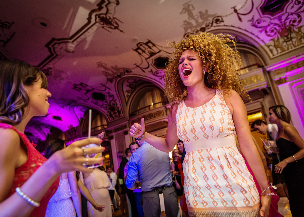 a female guest having some fun on dance floor during a fairmont chateau laurier ballroom wedding reception