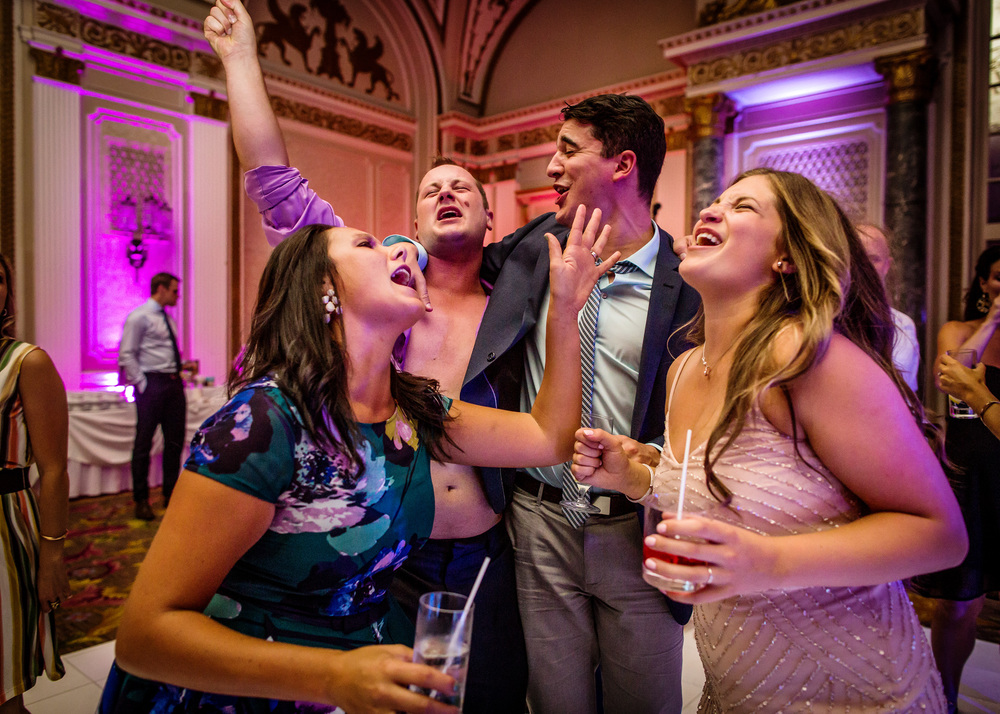 guests having some fun on dance floor during a fairmont chateau laurier ballroom wedding reception