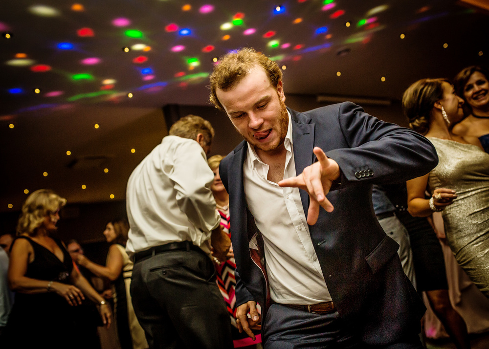 guest dances with tongue out at a le belvedere wedding reception in wakefield quebec