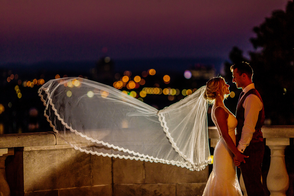 bride and groom portrait during sunset on terrace of chateau laurier wedding