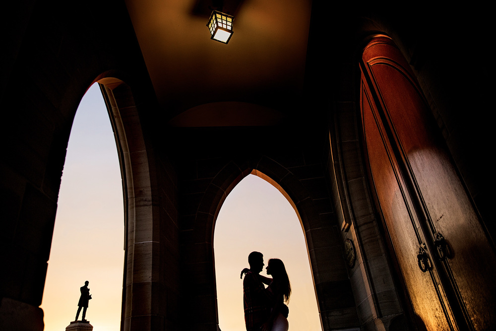 a couple pose near parliament hill during their engagement shoot
