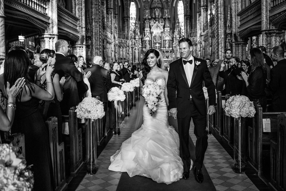 bride and groom exit the notre dame basilica cathedral church wedding