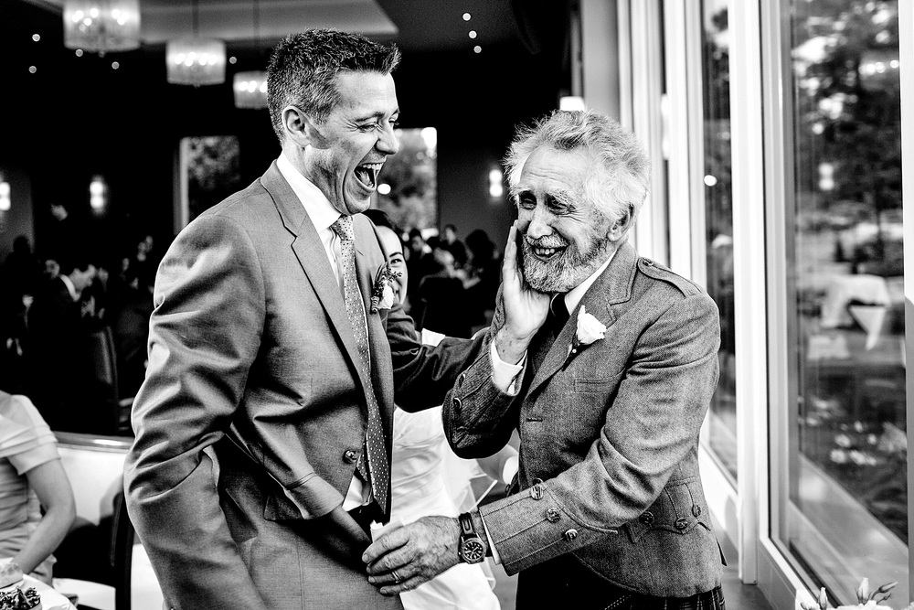 grooms father in law have a moment during a wedding at le belvedere