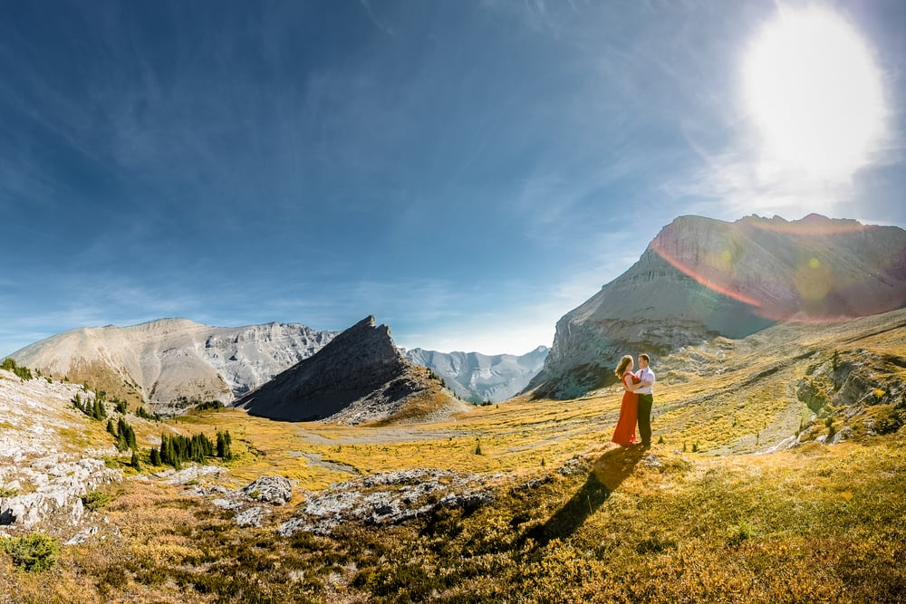 bride and groom on top of a mountain in banff