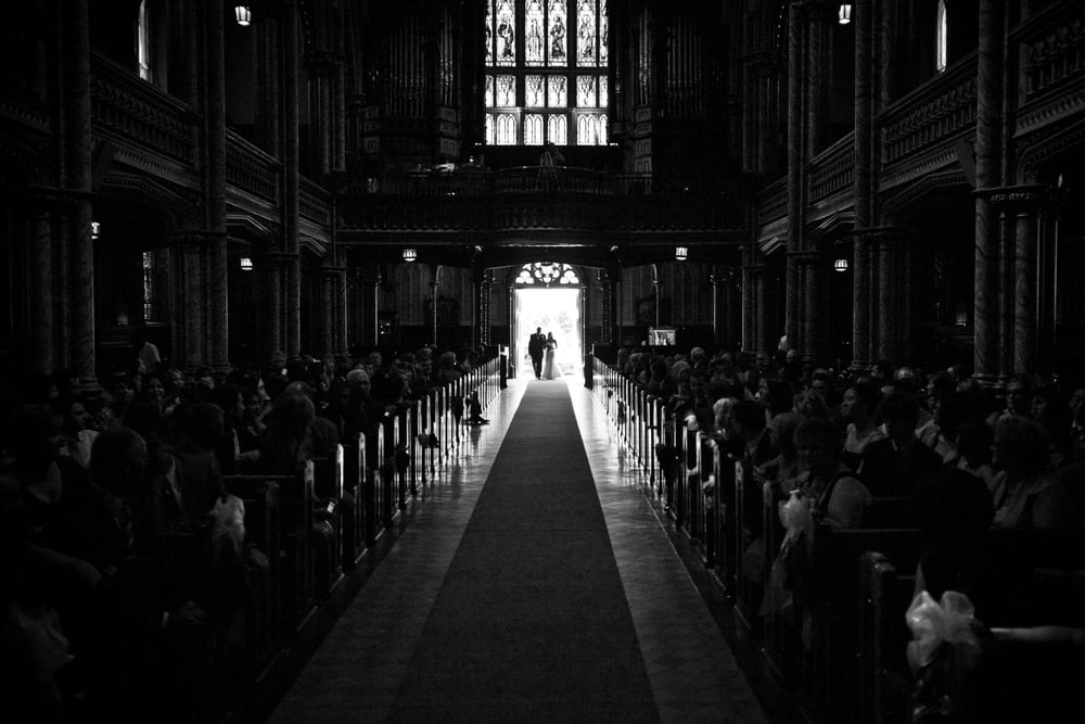 bride walking down isle in church