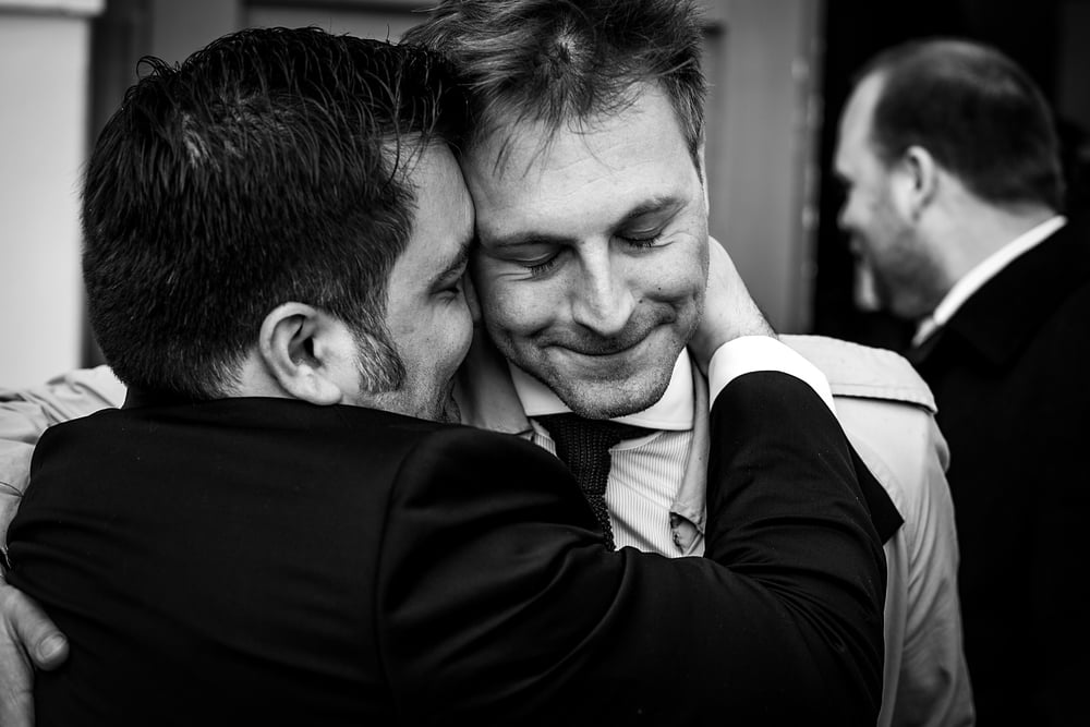 emotional moment between a groom and his friend