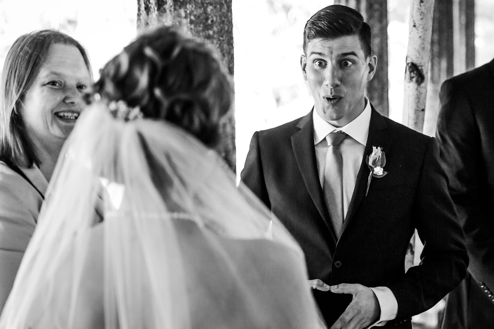 groom is super happy seeing his bride walk down the isle at rockcliffe pavillion