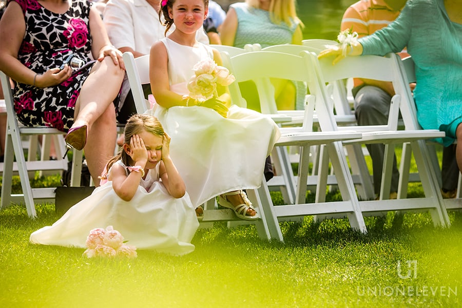 flower girl squeezing cheeks stonefields carlelton place wedding