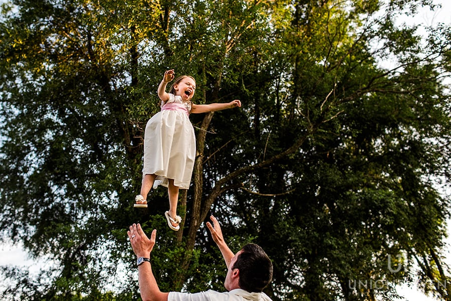 flying flower girl stonefields carlelton place wedding
