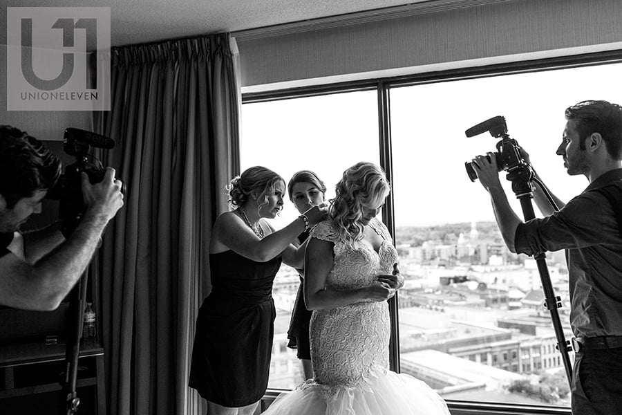 bride-getting-into-wedding-dress-westin-hotel-ottawa-wedding