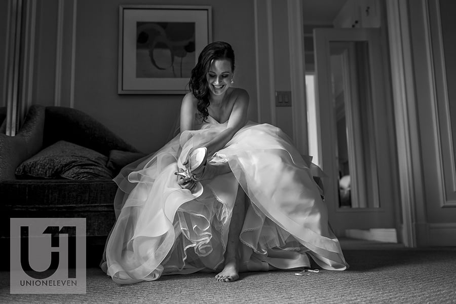 bride-putting-on-shoes-fairmont-chateau-laurier-03