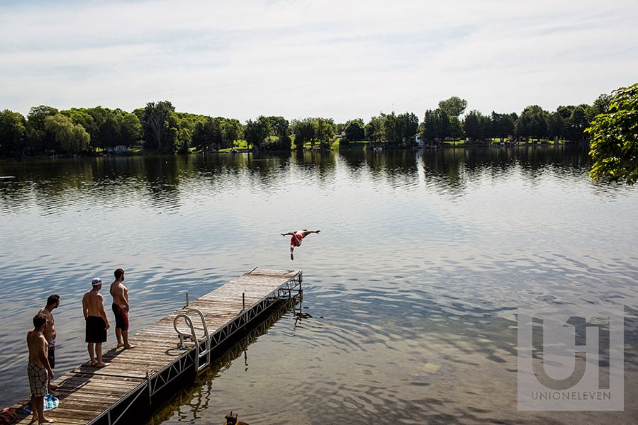 04-groom-jumping-into-the-lake-rideau-river-wedding