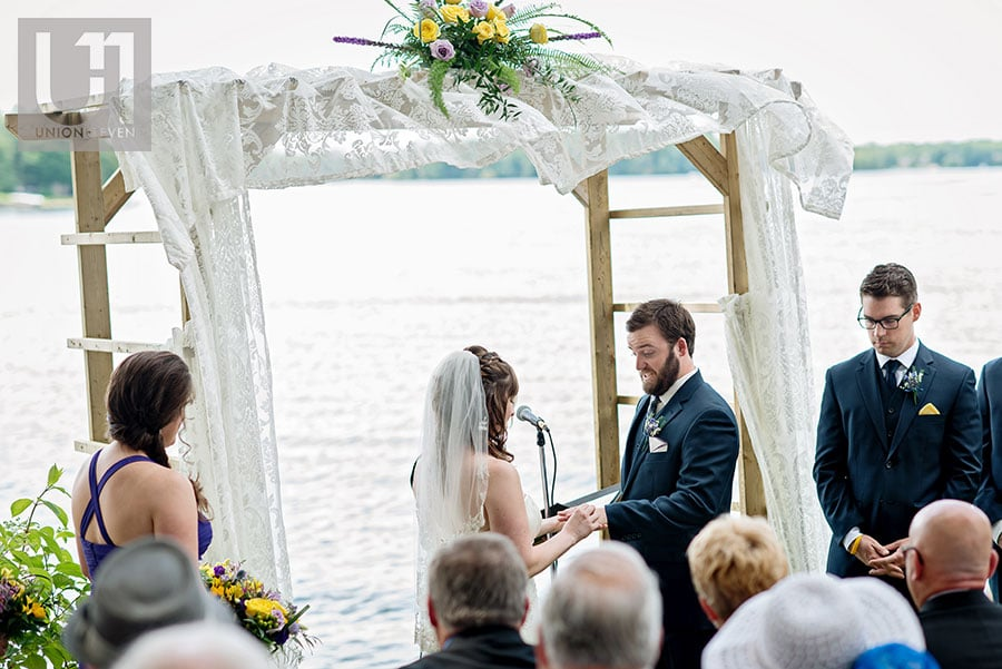 11-bride-groom-ring-exchange-cottage-ceremony-rideau-river-wedding