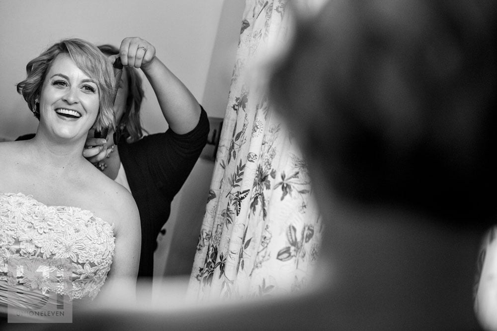 bride getting her hair done the morning of her wedding