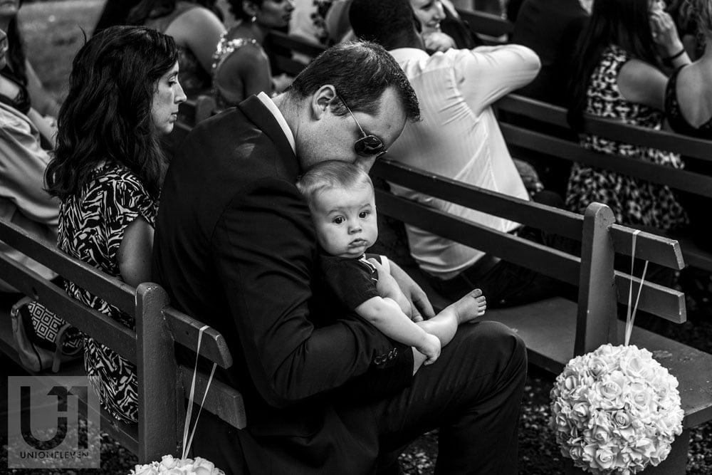 a photo of a baby during a wedding ceremony