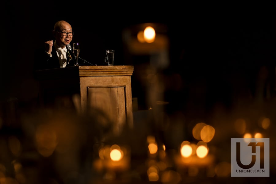 MC giving a speech at a wedding