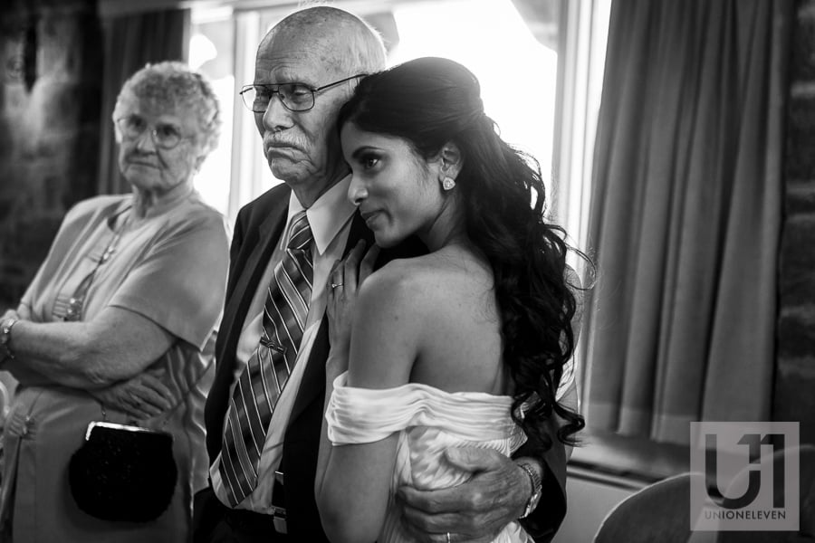 bride hugging grandfather after wedding ceremony