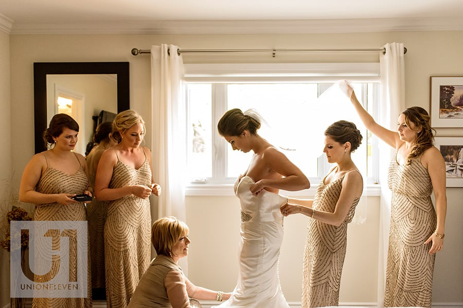 bridemaids mother helping bride into dress ottawa wedding