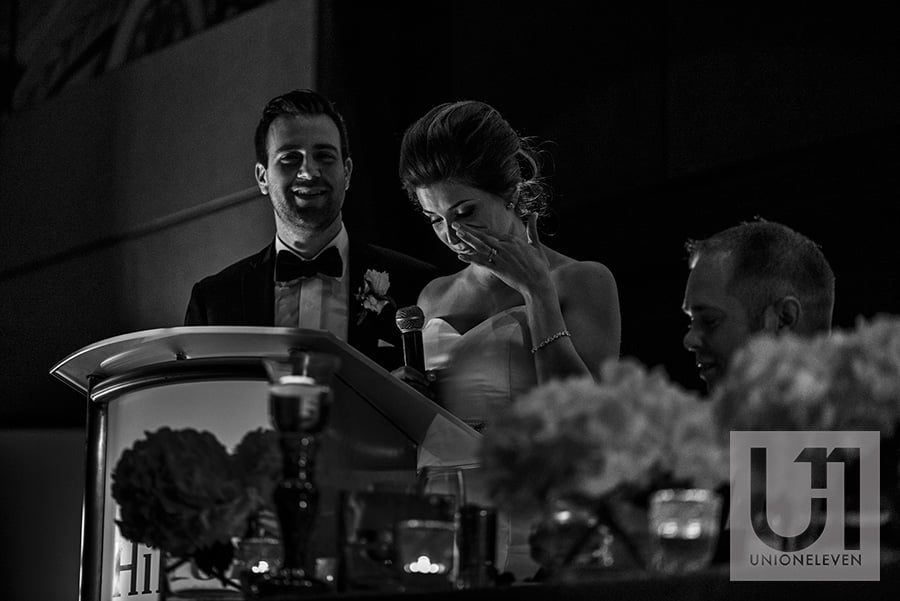 bride wiping tear to speech to parents hilton lac-leamy wedding