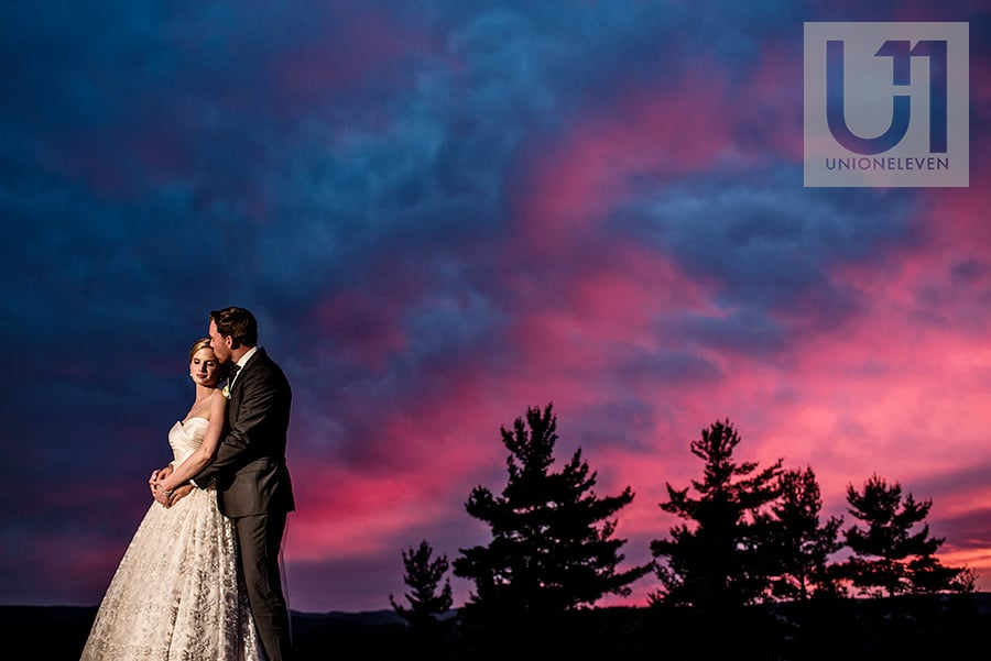 a sunset portrait of a bride and groom at a le belvedere wedding in wakefield