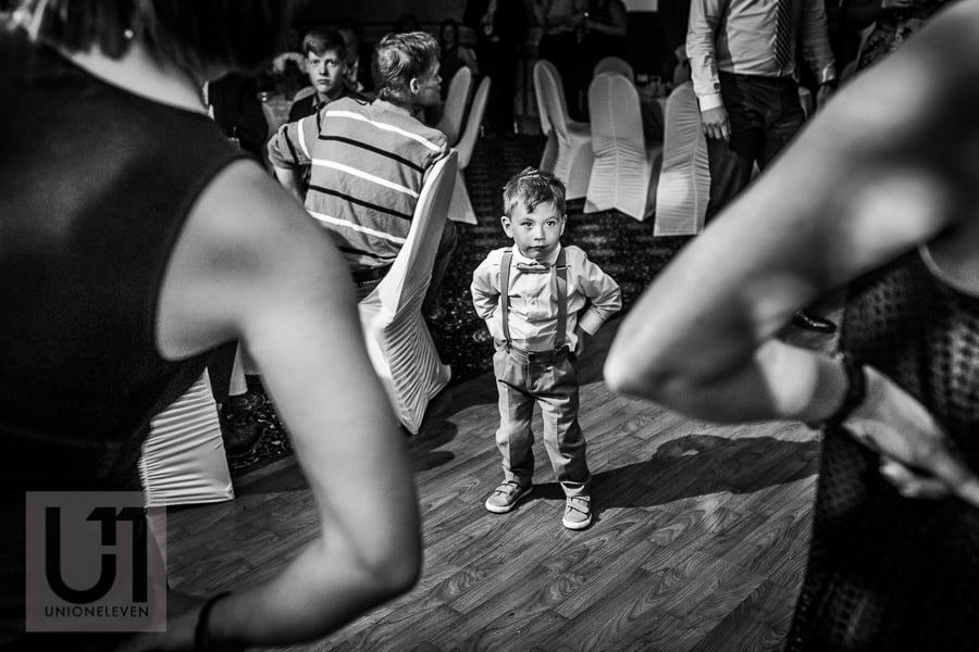young boy standing on dance floor with hands on hips